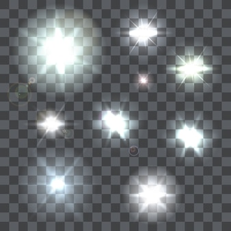 Set of nine lens flares beams and flashes on transparent background