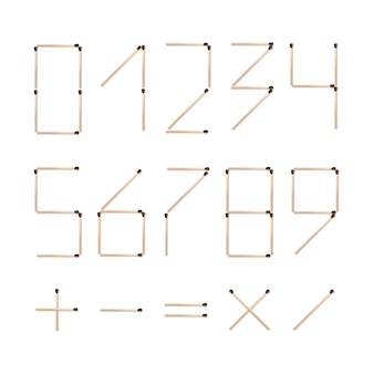 Set of numbers one two three four five six seven eight nine zero with mathematics signs   made of brown matches close up top view  on white background