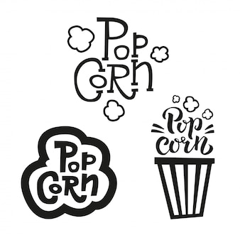 さまざまなスタイルの3つのポップコーンテキストラベルのセット。手描きのタイポグラフィサイン。ブラックホワイトロゴのコレクション。