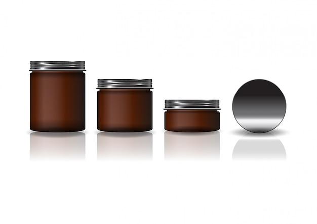검은 뚜껑이있는 3 가지 크기의 갈색 화장품 둥근 항아리 세트.
