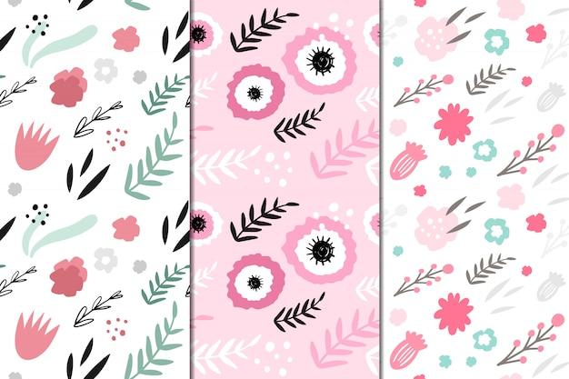 抽象的な花と3ベクトルシームレスパターンのセット。手描き、落書きスタイル。