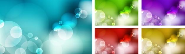 抽象的なぼやけた青い空、緑の自然、紫、赤、黄色の金色の背景とボケ光の効果のセットです。