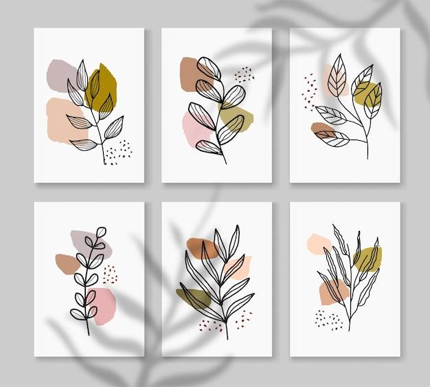 熱帯の葉と最小限の自然なスタイルの抽象的な自由奔放に生きる壁アートのセット。