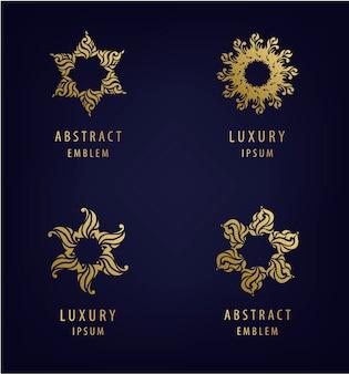黄金色の抽象的なモダンなロゴデザインテンプレートのセット
