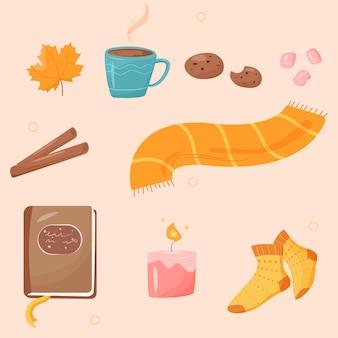フラット漫画スタイルの秋の居心地の良いもののセット。温かい飲み物、クッキー、マシュマロ、シナモン、カエデの葉、アロマキャンドル、暖かいスカーフと靴下、本。秋のステッカー。