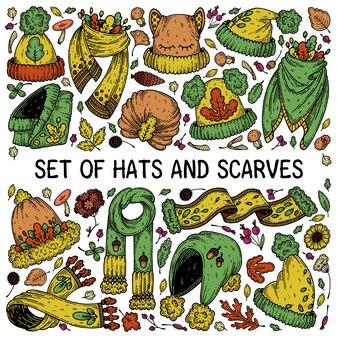 Комплект осенних шапок и шарфов.