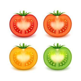 大きな熟したレッドグリーンオレンジイエローフレッシュカットトマトのセットが白い背景にクローズアップ
