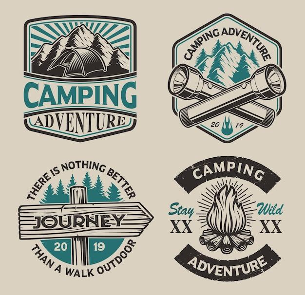 キャンプテーマの黒と白のロゴのセット。ポスター、アパレル、tシャツおよび他の多くに最適です。レイヤード