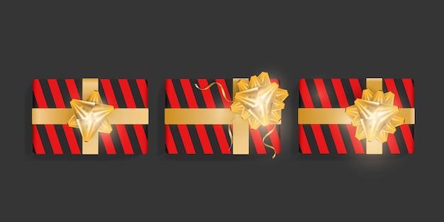 赤い縞模様の黒いギフトボックス、ゴールドのリボンの弓のセット。誕生日、クリスマス、新年のデザインのための美しいリアルなギフトボックステンプレート。上面図のベクトル図