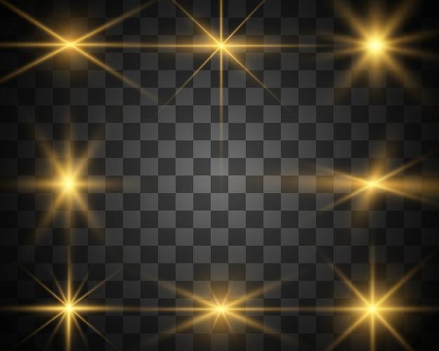 明るく美しい星のセットです。光の効果。輝く星。説明する美しい光。クリスマスの星。白い輝きが特別な光効果で輝きます。透明な背景の上で輝きます。