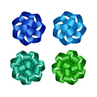 밝은 하늘색 푸른 에메랄드 녹색 선물 리본 활 세트 흰색 배경에 격리 닫습니다