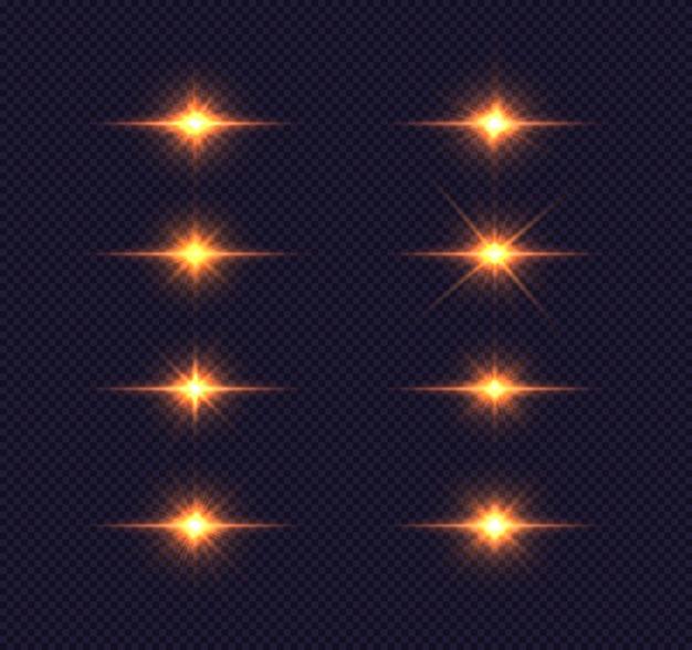 Набор яркой звезды. золотые светящиеся огни взрываются на синем прозрачном