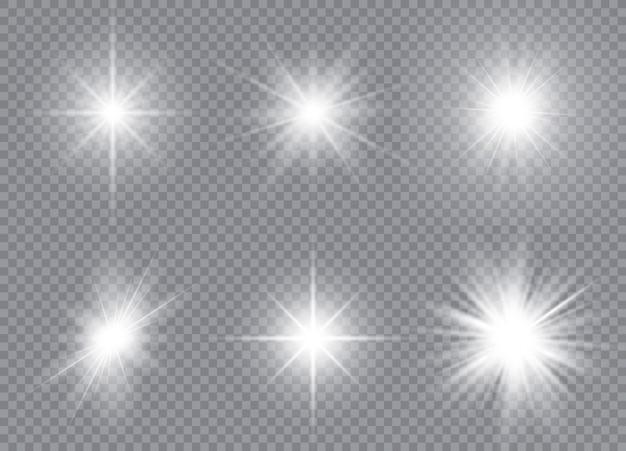 Набор ярких звезд. солнечный свет полупрозрачный световой эффект особого дизайна. иллюстрация.
