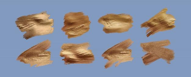 Набор мазков кистью. элементы дизайна гранж. золотая краска, тушь, кисти, линии, шероховатый. грязные художественные коробки, рамки. золотые линии изолированы. абстрактное золото блестящие текстурированные иллюстрации искусства.