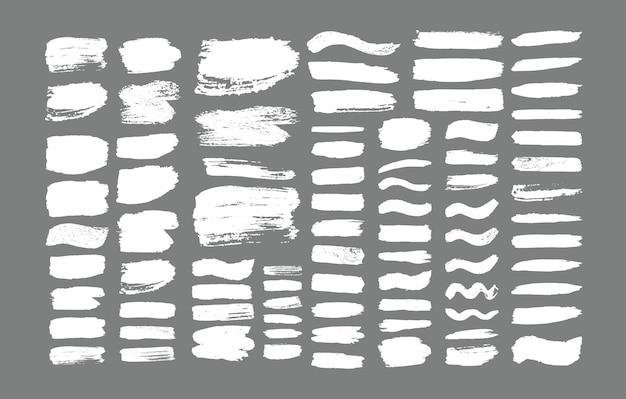 브러시 획의 집합입니다. 그런 지 디자인 요소입니다. 황금 페인트, 잉크, 브러쉬, 선, 지저분한. 더러운 예술적 상자, 프레임. 골드 라인 격리입니다. 추상 금 빛나는 질감 된 예술 그림.