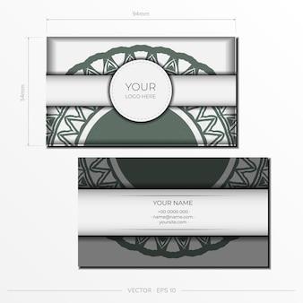 Набор визитных карточек. винтажный узор в современном стиле с заводами цикламена