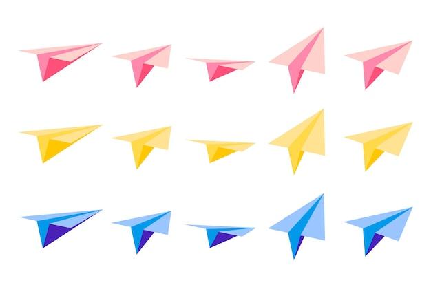 흰색 바탕에 다른 측면에서 볼 수있는 종이 접기 종이 비행기와 만화 삽화의 집합입니다.
