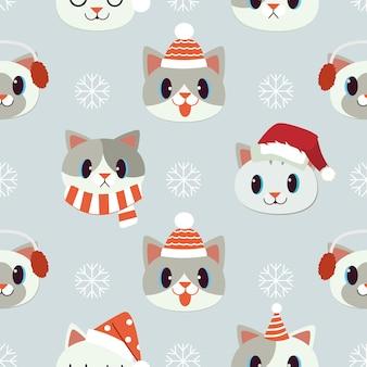 クリスマスアクセサリーのシームレスなパターンと猫のセット