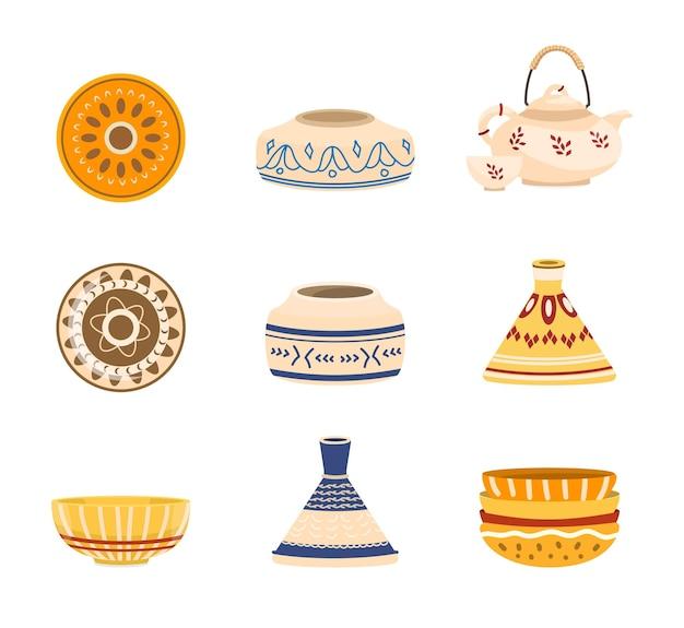 Набор керамических тарелок, чайник, кувшин, пиалы, ваза с орнаментом