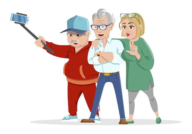 陽気な高齢者のヒップスターが集まって楽しんでいるセット。スティックで自分撮り写真を撮る高齢者のグループ。祖父と祖母。