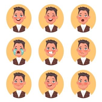 さまざまな感情を表現する子供の男の子のアバターのセット。笑顔、笑い、恐怖、困惑、怒り、涙、悲しみ、ウインク、憎しみ。漫画のスタイルのイラスト。