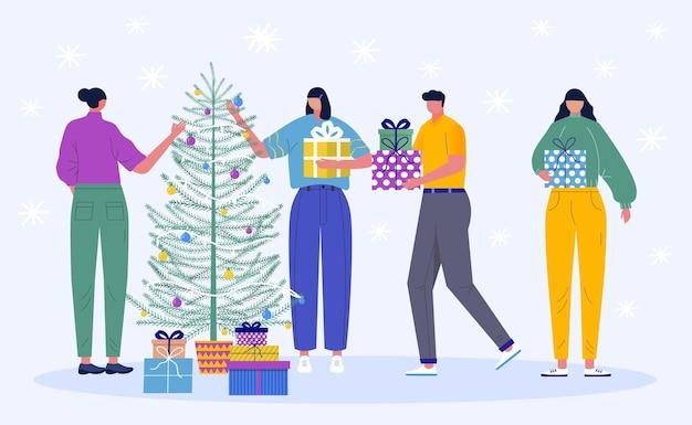 크리스마스 캐릭터의 집합입니다. 젊고 아름다운 사람들이 크리스마스 트리를 장식합니다. 크리스마스 트리와 눈송이 아래 선물