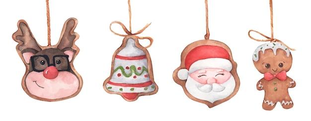 ひもにぶら下がっているクリスマスジンジャーブレッドクッキーのセット。水彩イラスト。