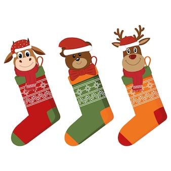 Набор рождественских носков с подарками, персонажами-животными.