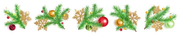 Набор веток елки с шарами, золотыми снежинками и кусочками серпантина на белом фоне