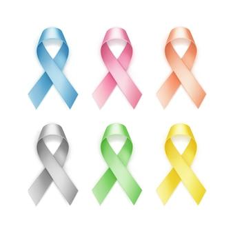 Набор цветных лент рака молочной железы на белом фоне