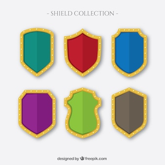 Set of colored shields with golden outline