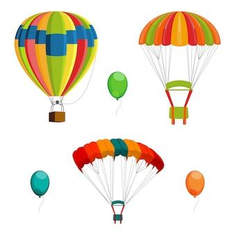 Набор красочных воздушных шаров и парашютов.