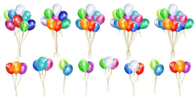 Набор разноцветных шаров с лентами на белом
