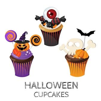 Набор красочных кексов хэллоуина и конфет.