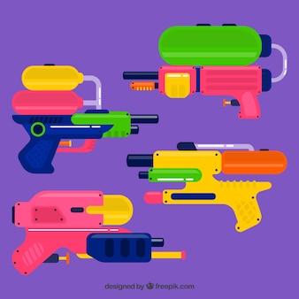 Набор красочных водяных пушек с пластмассовым материалом Бесплатные векторы