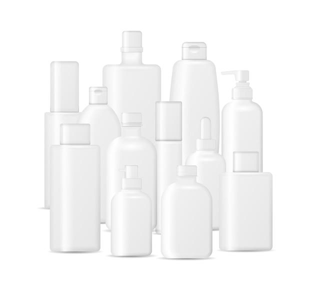 白い背景で隔離の化粧品ボトルのセット。クリーム、スープ、泡、シャンプーのパッケージコレクション。