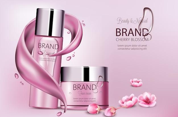 エッセンスとフェイスクリームの化粧品のセット。製品の配置。桜の花。スプラッシュ波と滴。ブランドのための場所。現実的な