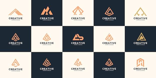 創造的な文字と抽象的なロゴのセット