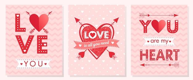 Набор творческих карт дня святого валентина. рисованной надписи с сердечками, стрелами и лентами. романтичный