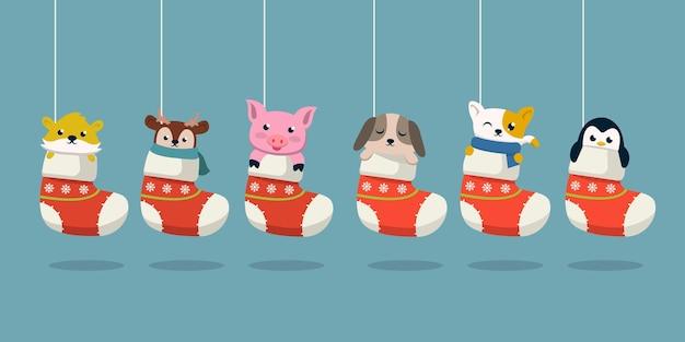 靴下のかわいい動物のセットクリスマスデザインイラスト
