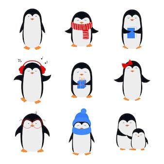 フラットスタイルのかわいい漫画ペンギンのセット