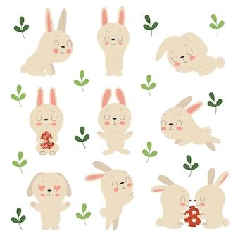 귀여운 부활절 토끼, 꽃 및 장식 된 계란의 집합입니다. 부활절의 전통적인 상징. 다른 포즈의 재미있는 동물.
