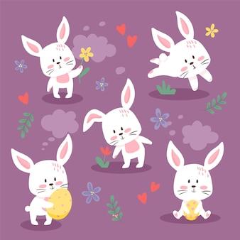 Набор милых пасхальных кроликов. коллекция милых маленьких кроликов. мультяшный плоский стиль. Premium векторы