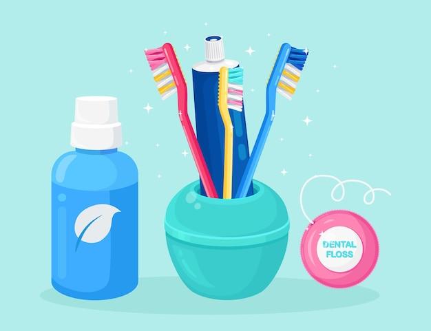 歯のクリーニング、ホワイトニングツールのセット。歯ブラシ、歯磨き粉、うがい薬、デンタルフロス。オーラルケア