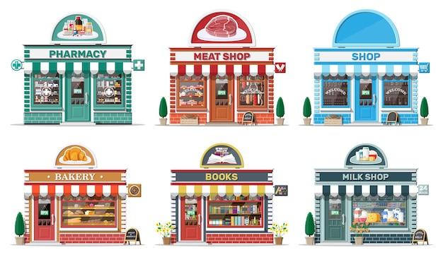 상세한 도시 상점 건물의 집합입니다. 빵집, 책, 우유, 고기, 약국, 식료품점. 작은 유럽 스타일의 가게 외관. 상업, 부동산, 시장 또는 슈퍼마켓. 평면 벡터 일러스트 레이 션