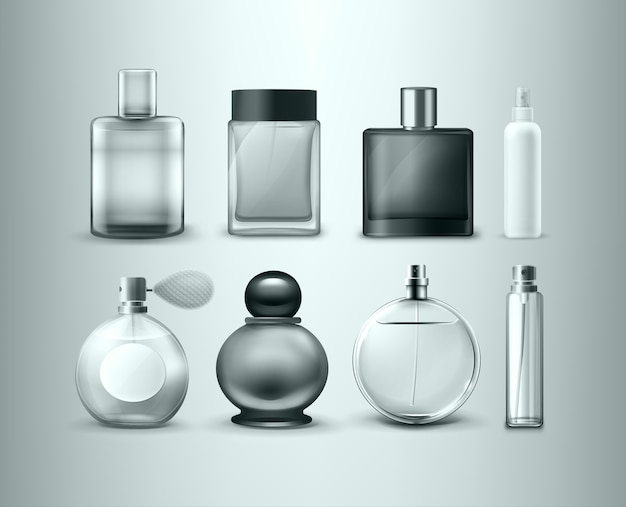 灰色の背景に分離されたさまざまな香水瓶のセット