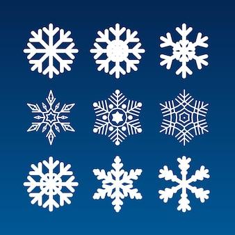 Набор различных снежинок на синем фоне. векторная иллюстрация.