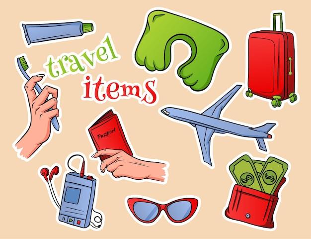ベージュの背景図に旅行アイテムのテキストとさまざまな旅行アイテムのセット