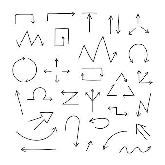白い背景に落書き矢印のセット。黒の筆と鉛筆で手作り。手描きのまっすぐでねじれたマーカー