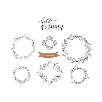Набор каракули цветочные линии листьев ветви круг кадров. хансд нарисовал эскиз иллюстрации